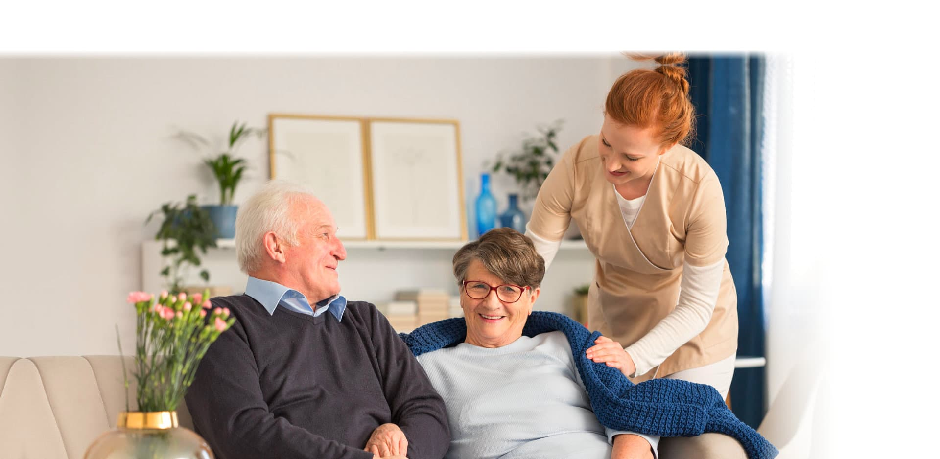 senior man and woman with caregiver