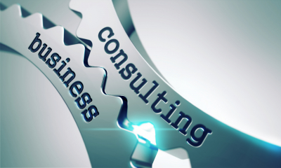 business and consulting word on mechanical gears